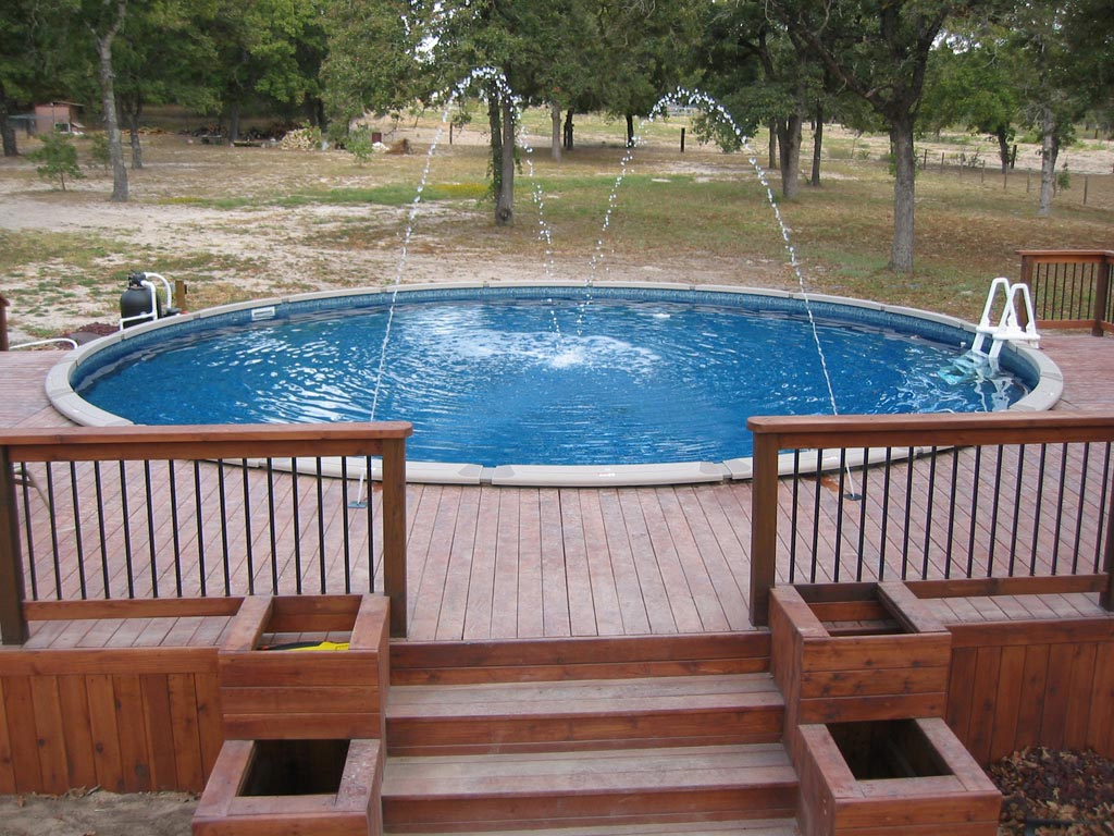 Above ground pool fountain fountain design ideas for Pool deck decor ideas