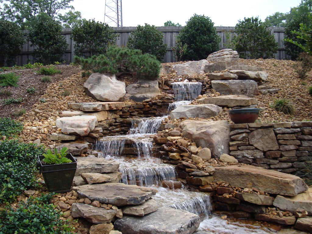 Backyard rock water fountains fountain design ideas for Waterfall features