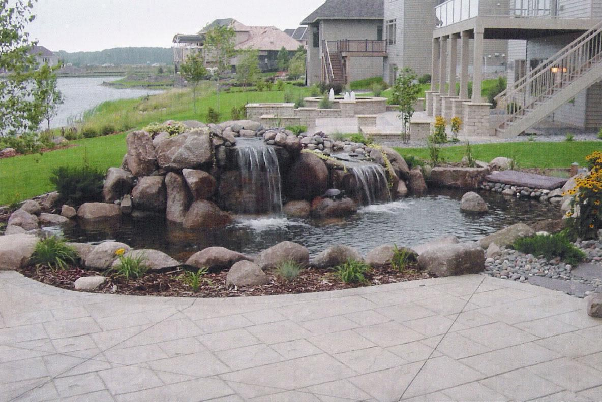 Rock column fountains fountain design ideas for Rock ponds designs
