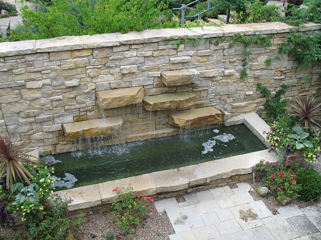 Rock wall fountain fountain design ideas for Outdoor wall fountains