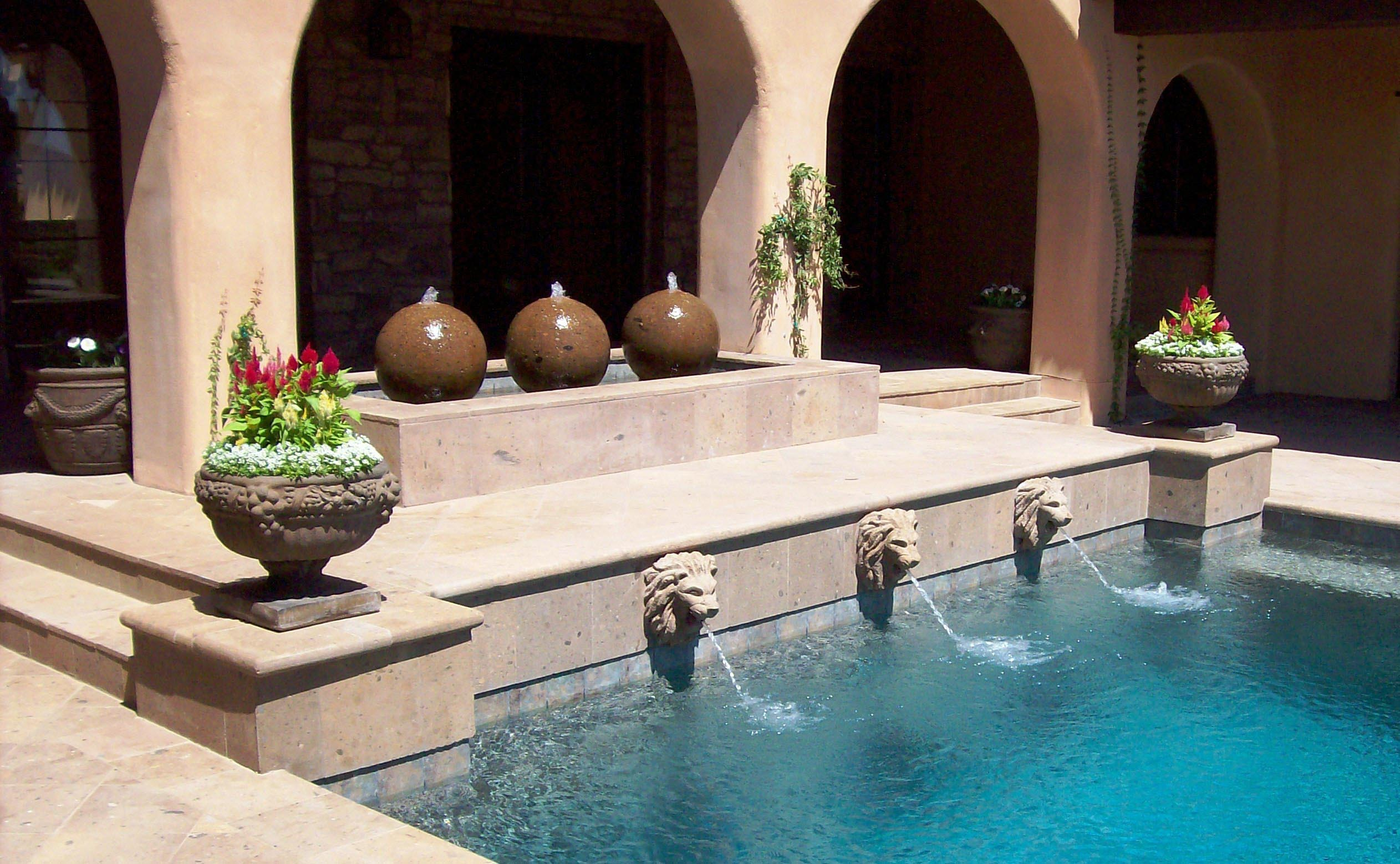 Swimming pool fountain heads fountain design ideas for Garden pool fountains