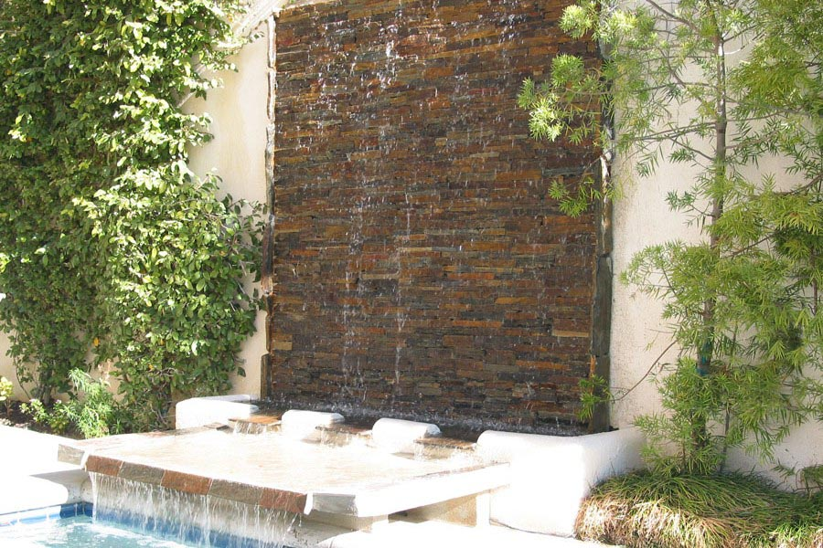 Wall fountains outdoors fountain design ideas for Outdoor wall fountains